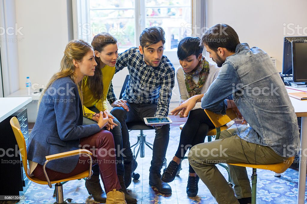 Group of young creative people at a startup meeting stock photo