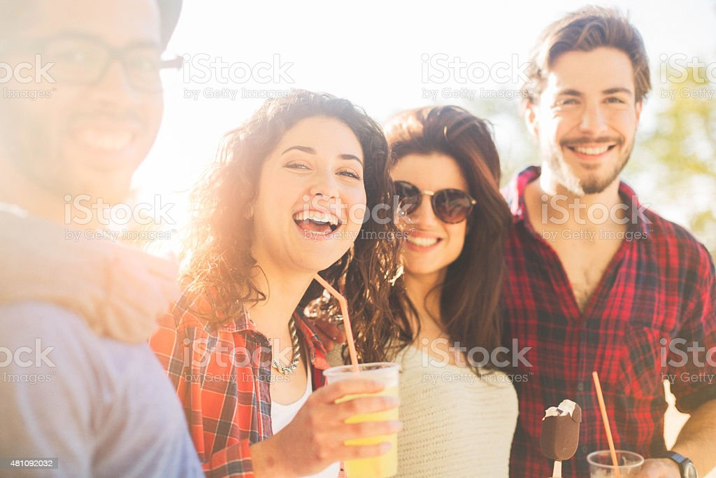 Group of young friends enjoying a spring afternoon. stock photo