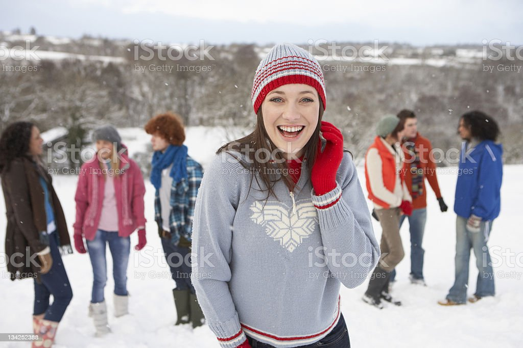 Group Of Young Friends Having Fun In Snowy Landscape royalty-free stock photo