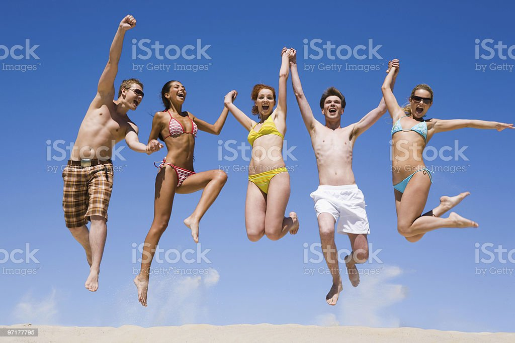 Group of young friends jumping for joy royalty-free stock photo