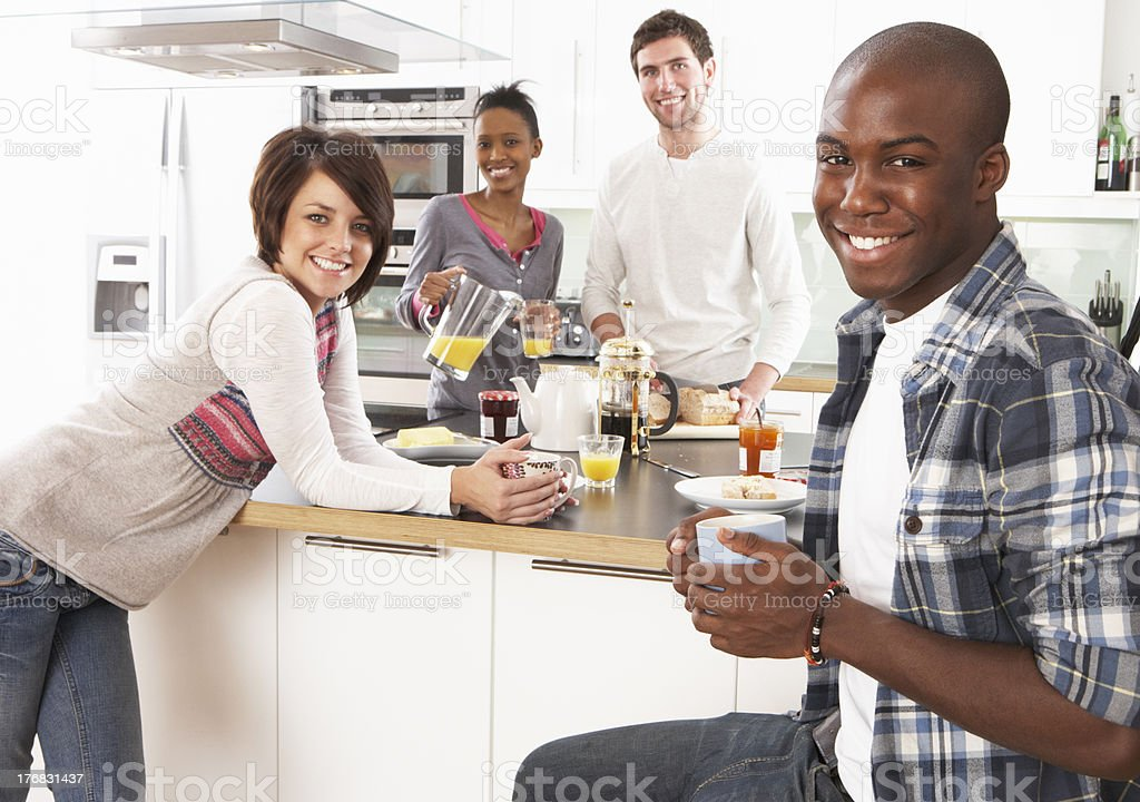 Group Of Young Friends Preparing Breakfast Kitchen royalty-free stock photo
