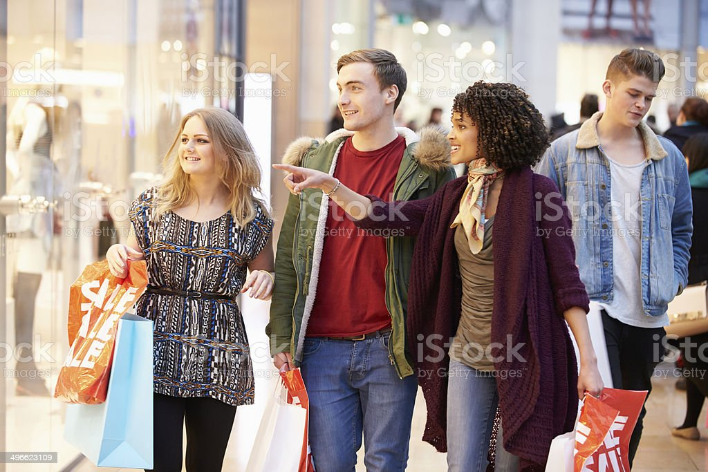 Group Of Young Friends Shopping In Mall Together stock photo