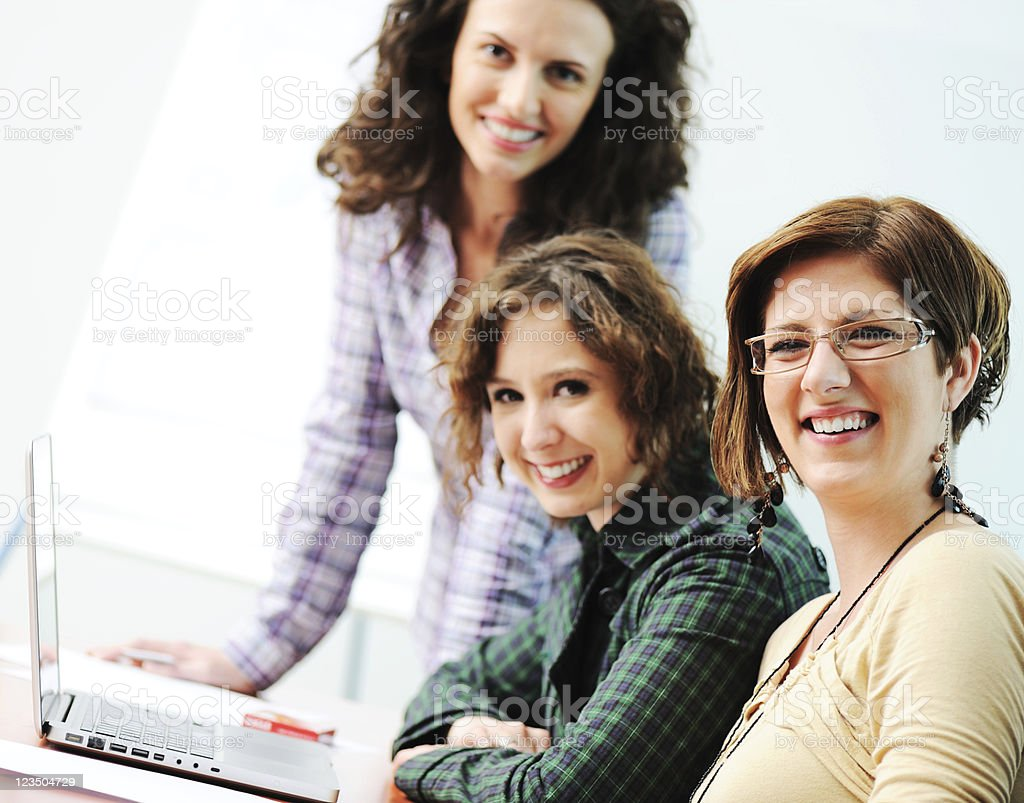 Group of young happy female coleagues working in office royalty-free stock photo
