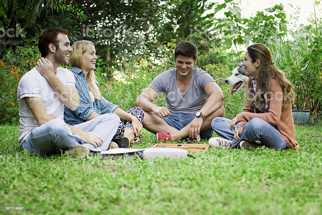 Group of young happy friends in park royalty-free stock photo