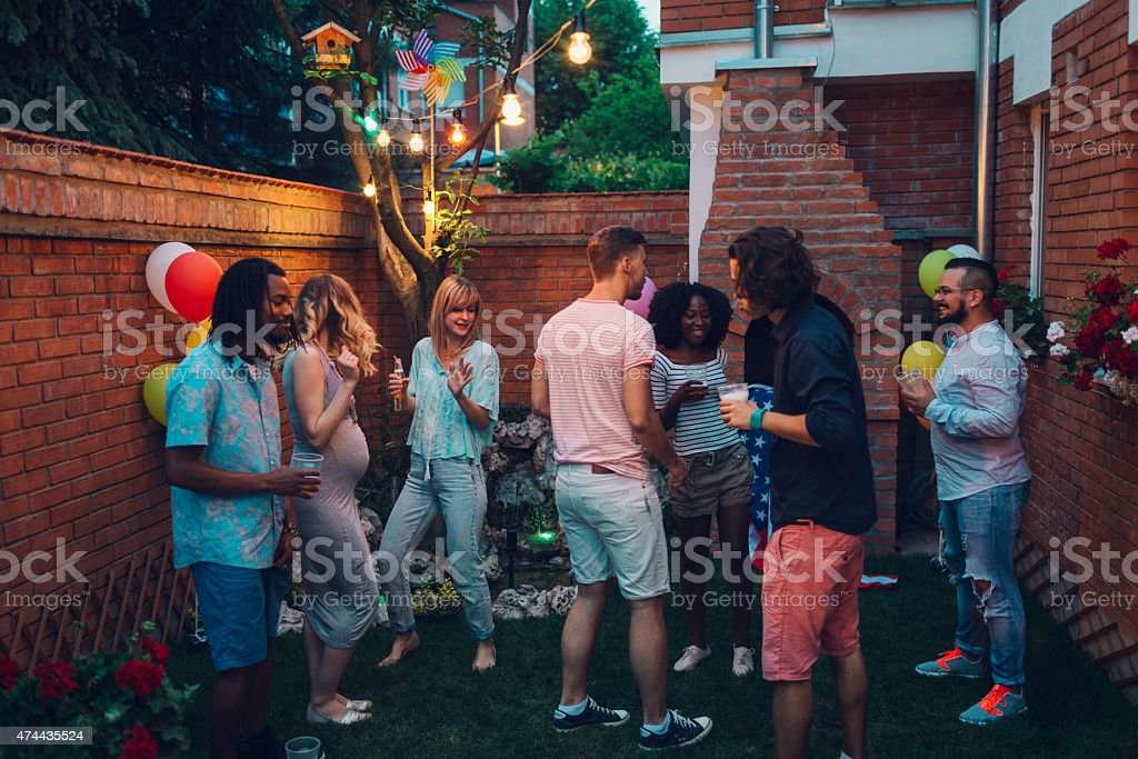 Group Of Young Happy People Dancing At Backyard Party. stock photo