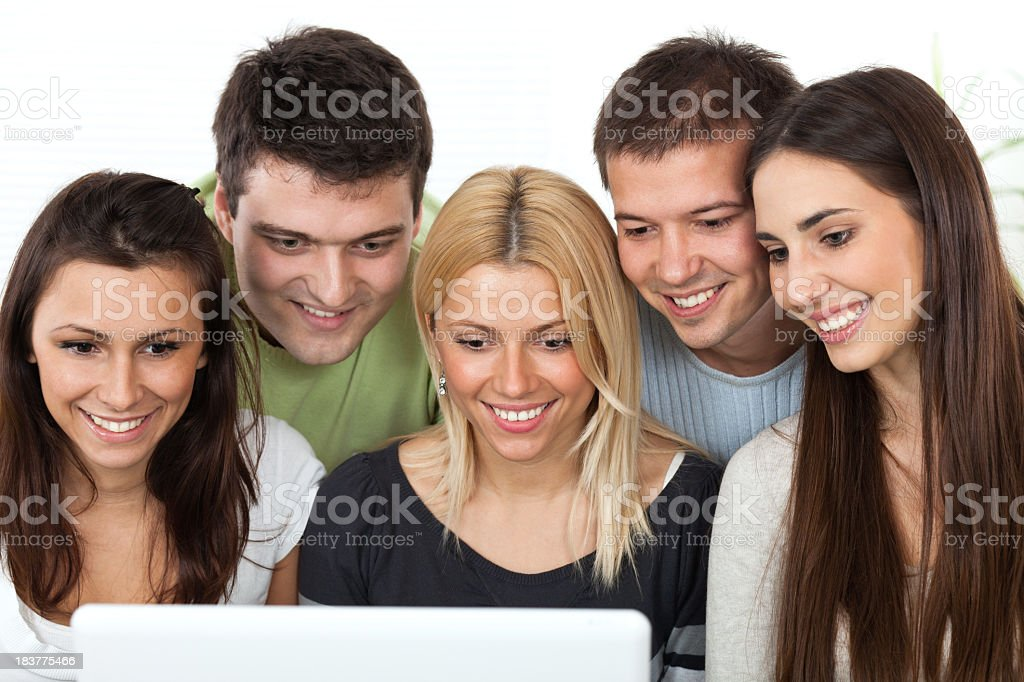 Group of young happy people working on laptop royalty-free stock photo
