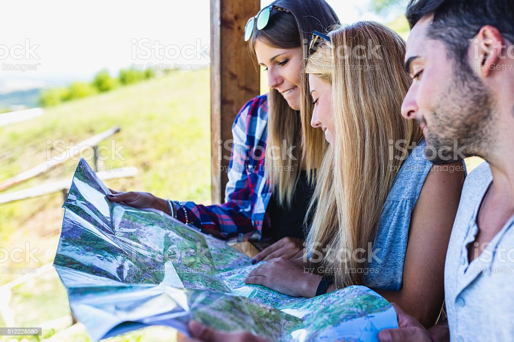 Group of young hikers with a map stock photo