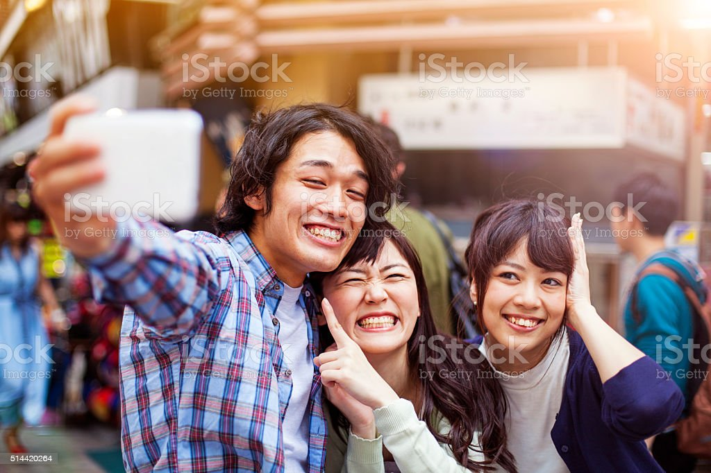 Group of young japanese people making selfie, Tokyo, stock photo