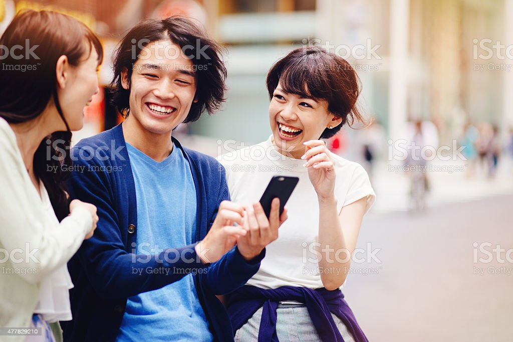 Group of young japanese people with smart phone stock photo