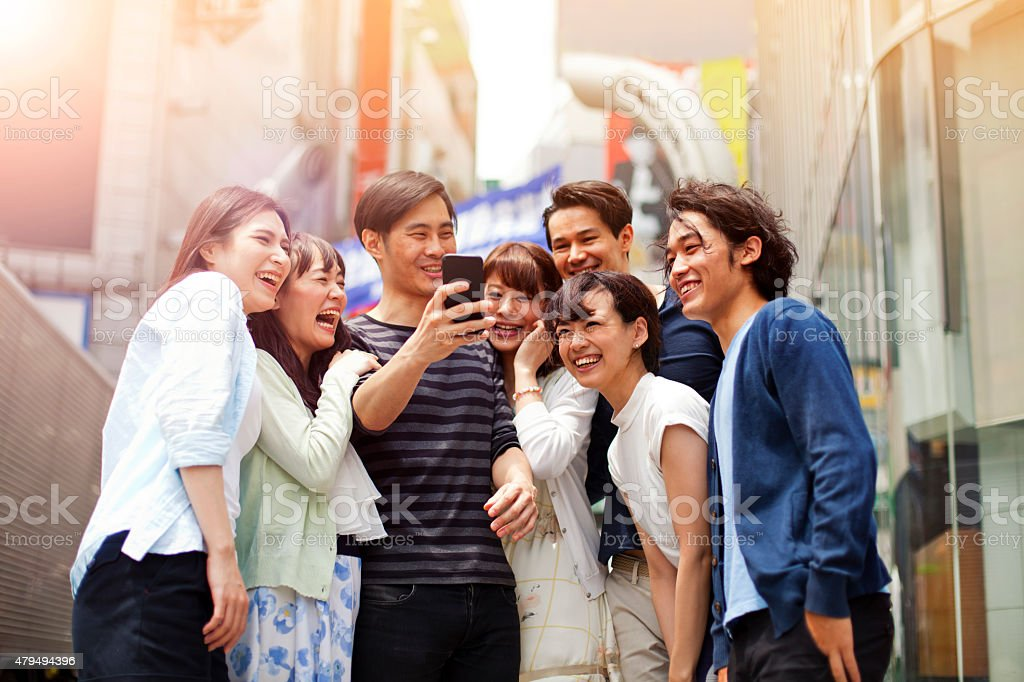 Group of young japanese people with smart phone, Shibuya, Tokyo. stock photo