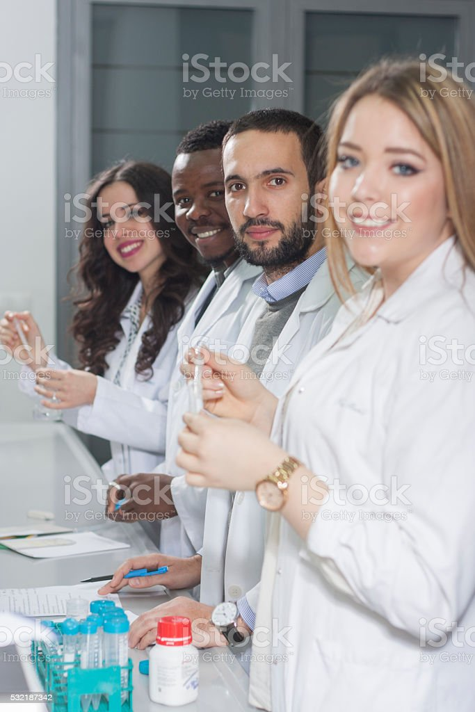 Group of young medical workers are working in lab stock photo