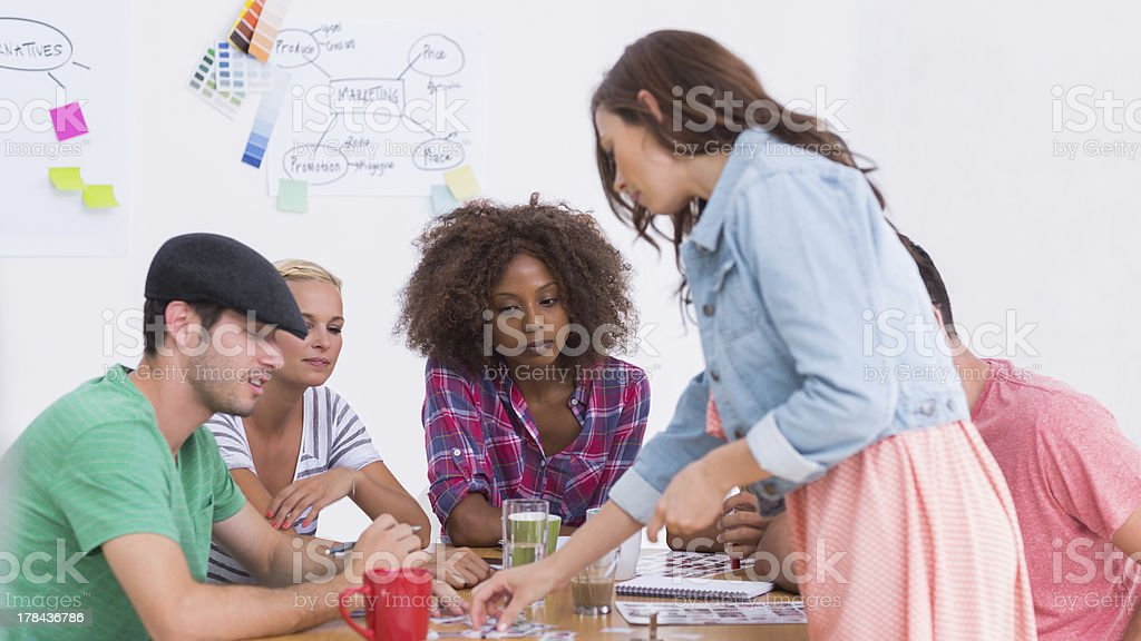 Group of young men and women brainstorming project ideas royalty-free stock photo