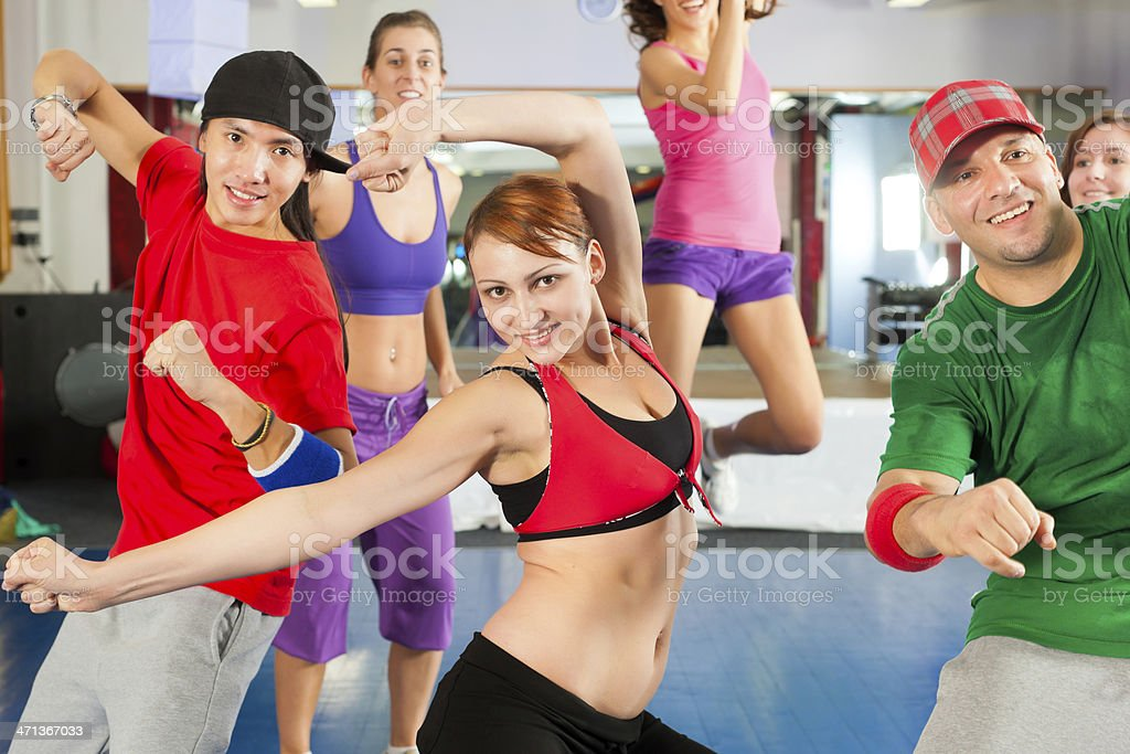 Group of young men and women dance training in gym royalty-free stock photo