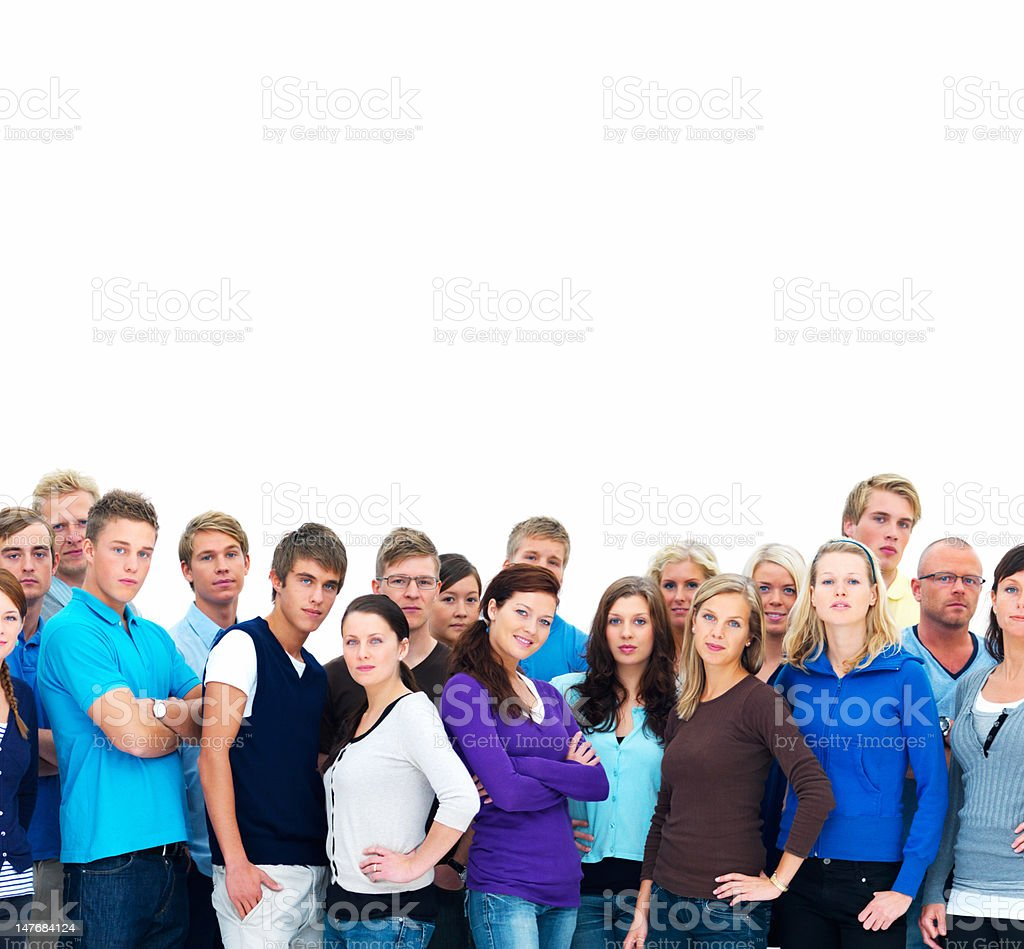 Group of young men and women standing together royalty-free stock photo