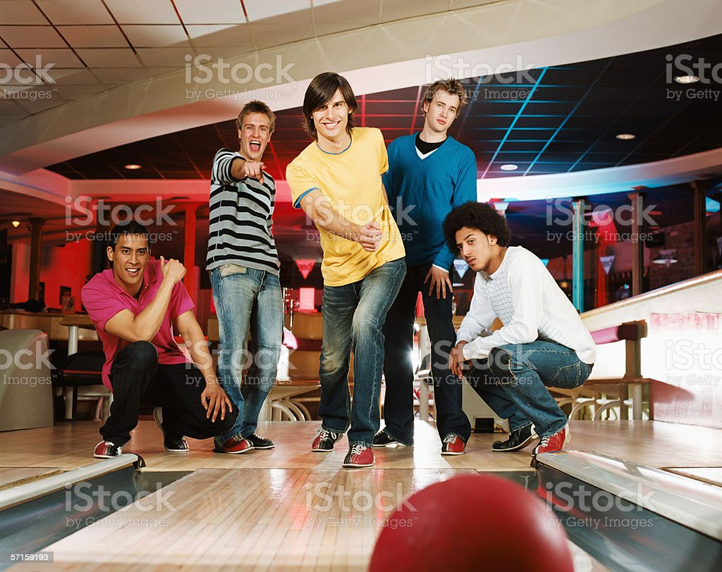 Group of young men bowling stock photo