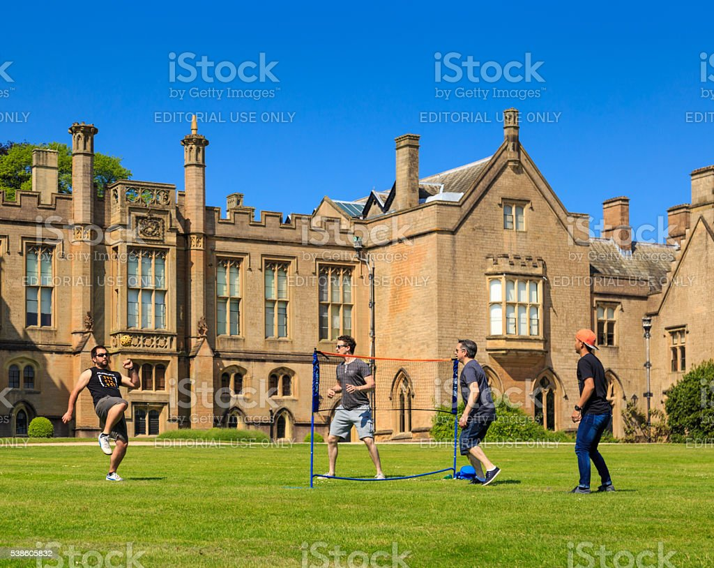 group of young men playing Sepak Takraw (kick volleyball) stock photo