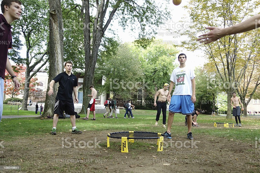 Group of young men playing spike ball stock photo