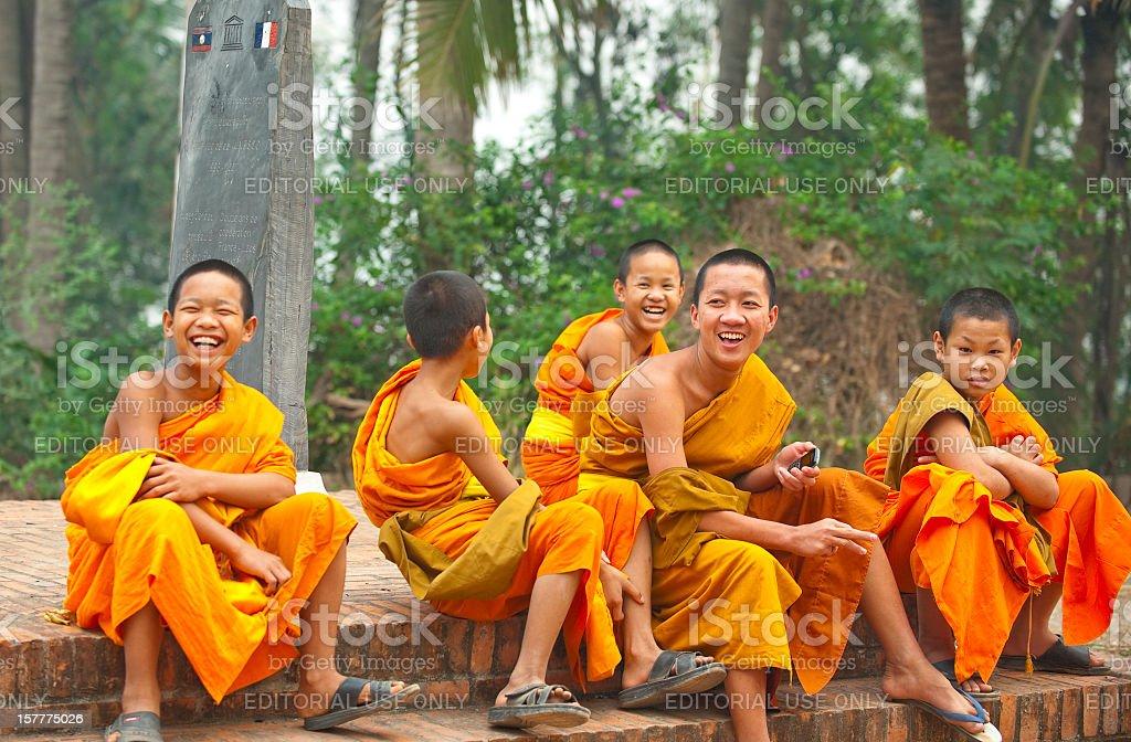 Group of young monks laughing, Laung Prabang, Laos stock photo