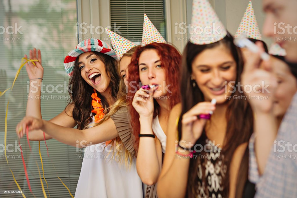 Group of young people celebrating birthday on the street stock photo
