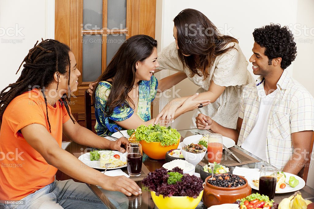 Group of young people celebrating something over lunch royalty-free stock photo