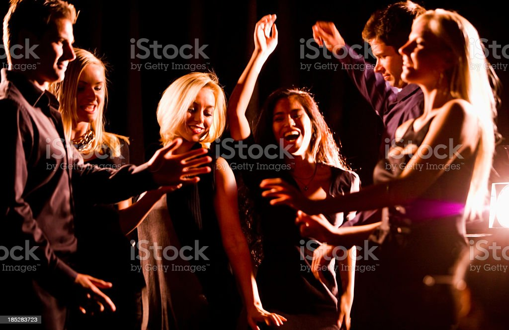 Group of young people dancing in nightclub royalty-free stock photo