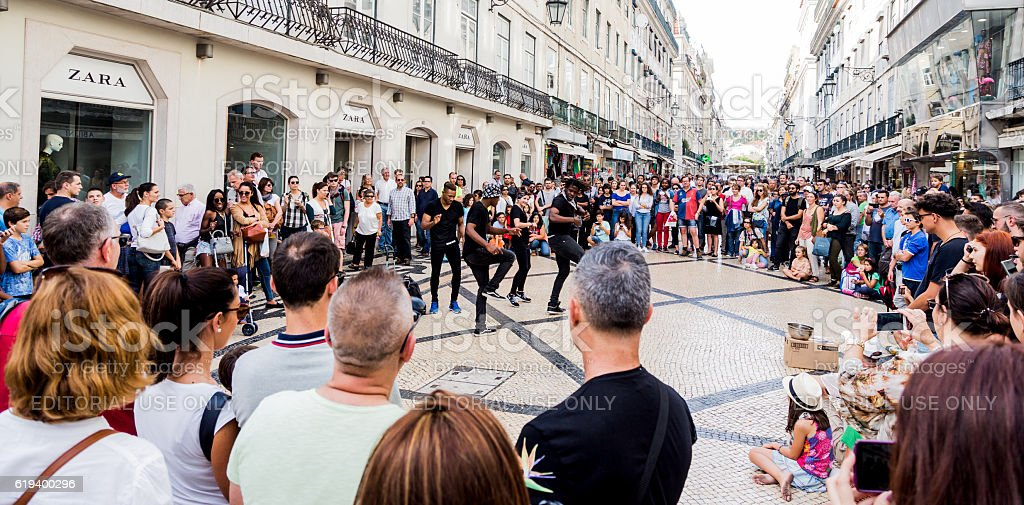 Group of young people dancing in the street. stock photo
