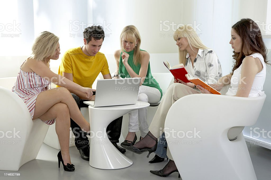 Group of young people discussing at laptop stock photo