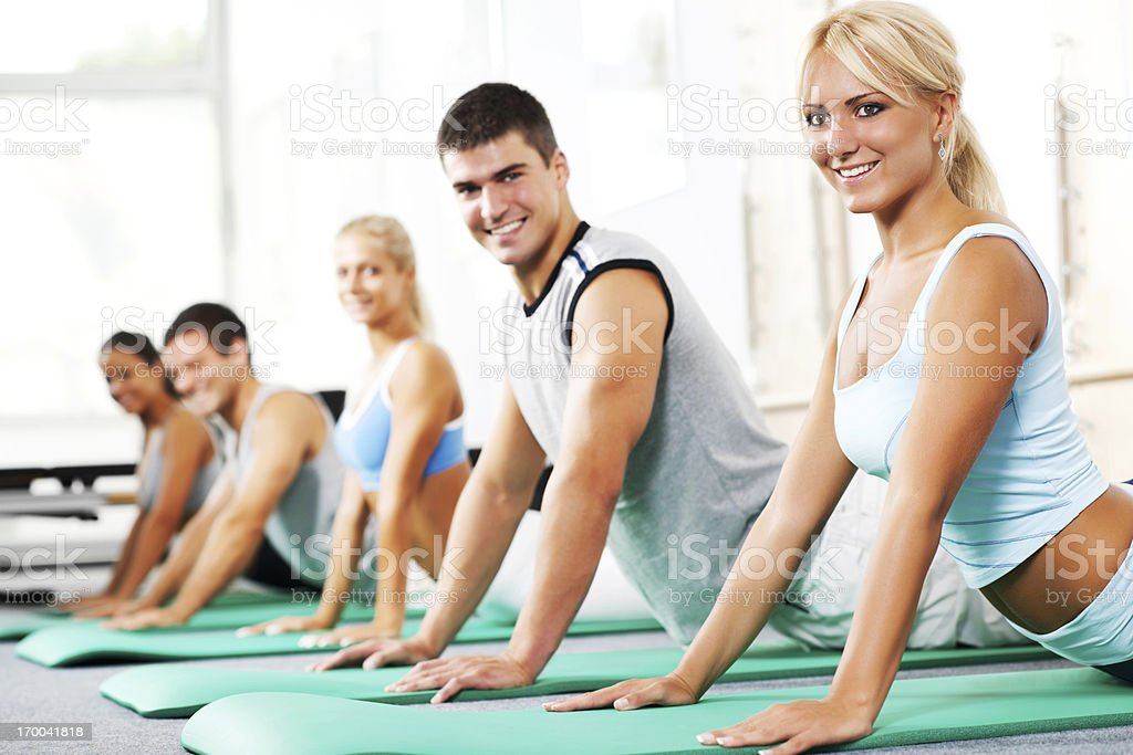 Group of young people doing Pilates exercises. royalty-free stock photo
