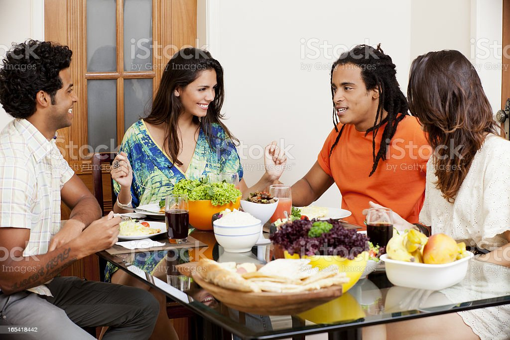 Group of young people enjoying conversation over lunch stock photo