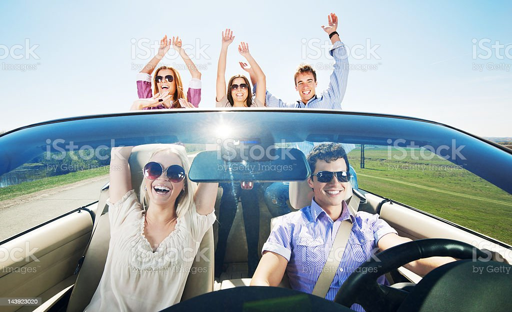 Group of young people enjoying in a Convertible car ride. royalty-free stock photo
