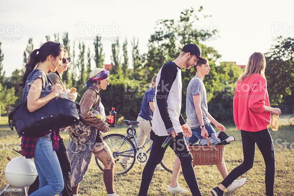 Group of young people going on day trip stock photo