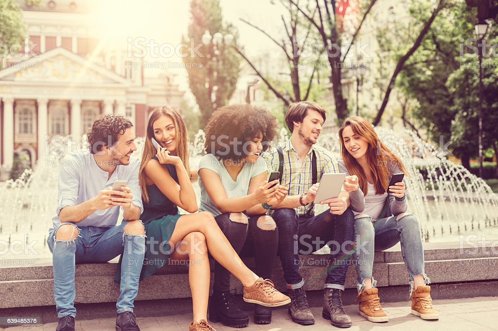 Group of young people hanging out stock photo