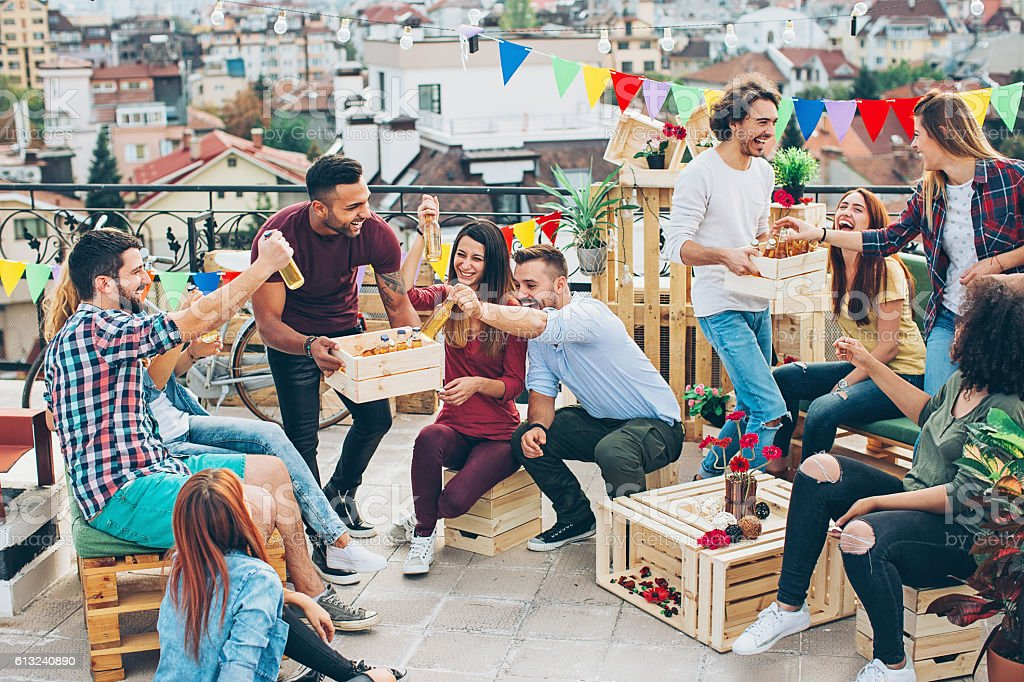 Group of young people having a rooftop party stock photo