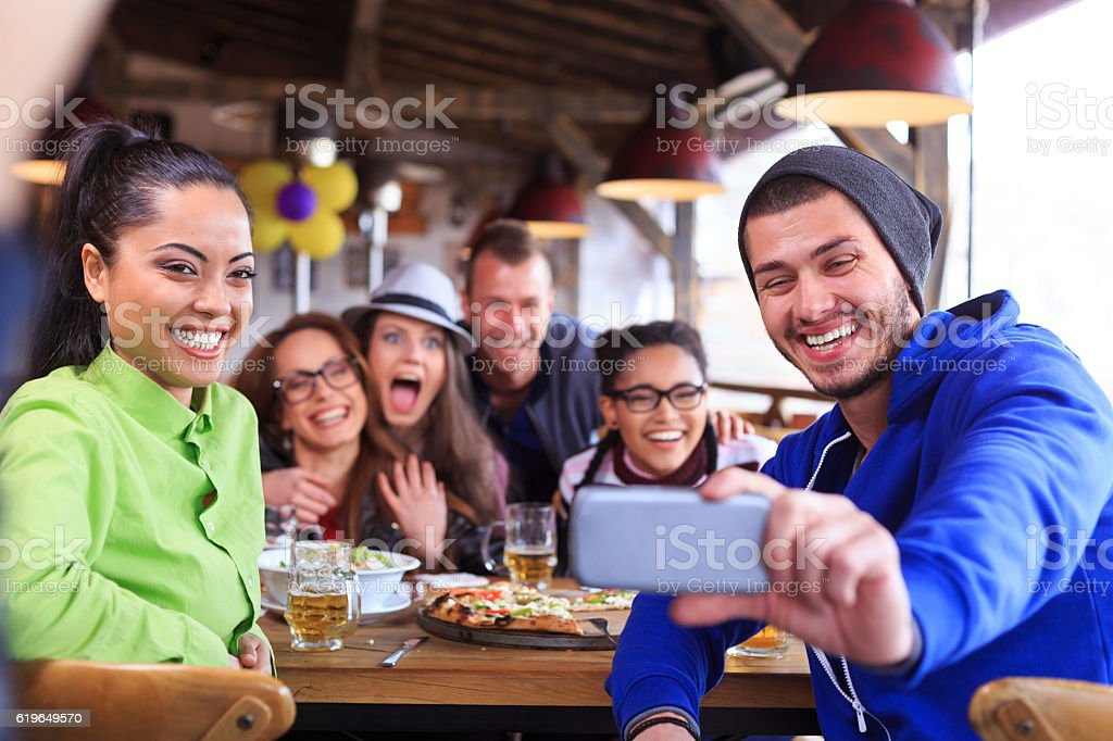 Group of young people having fun and making selfie stock photo