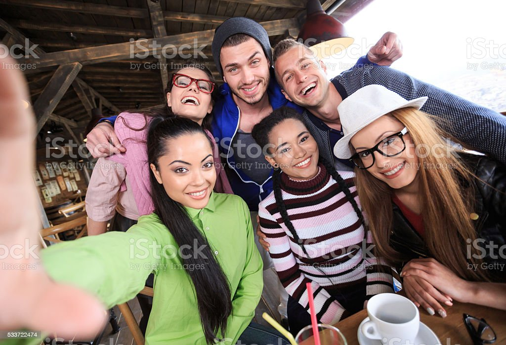 Group of young people having fun and taking selfie stock photo