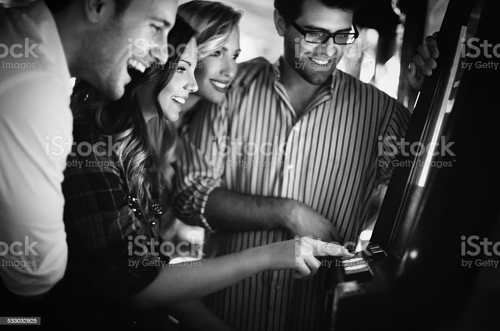 Group of young people having fun in casino. stock photo