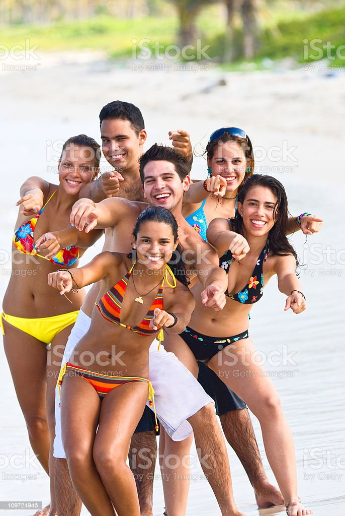 Group of Young People Having Fun on Beach royalty-free stock photo