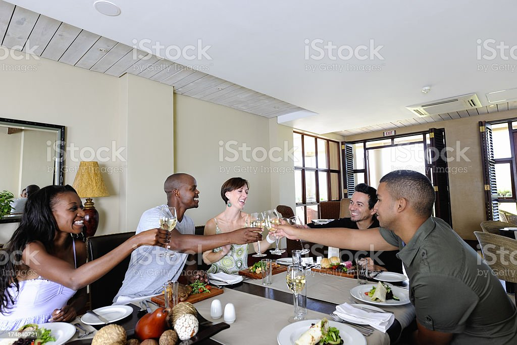 Group of Young People Having Good Time in Restaurant stock photo