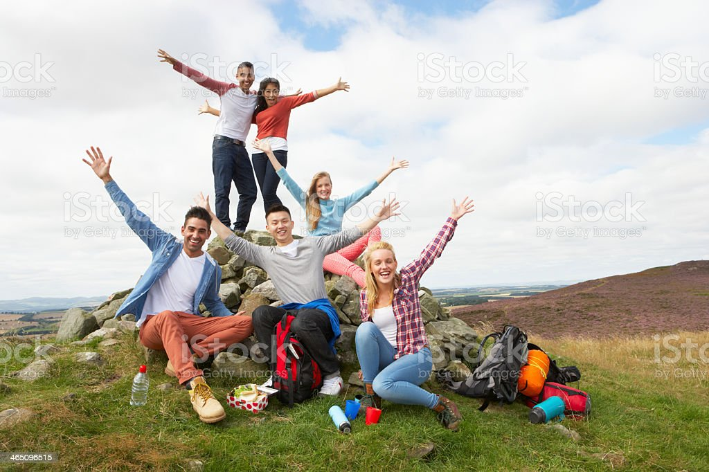 Group of young people hiking in the country stock photo