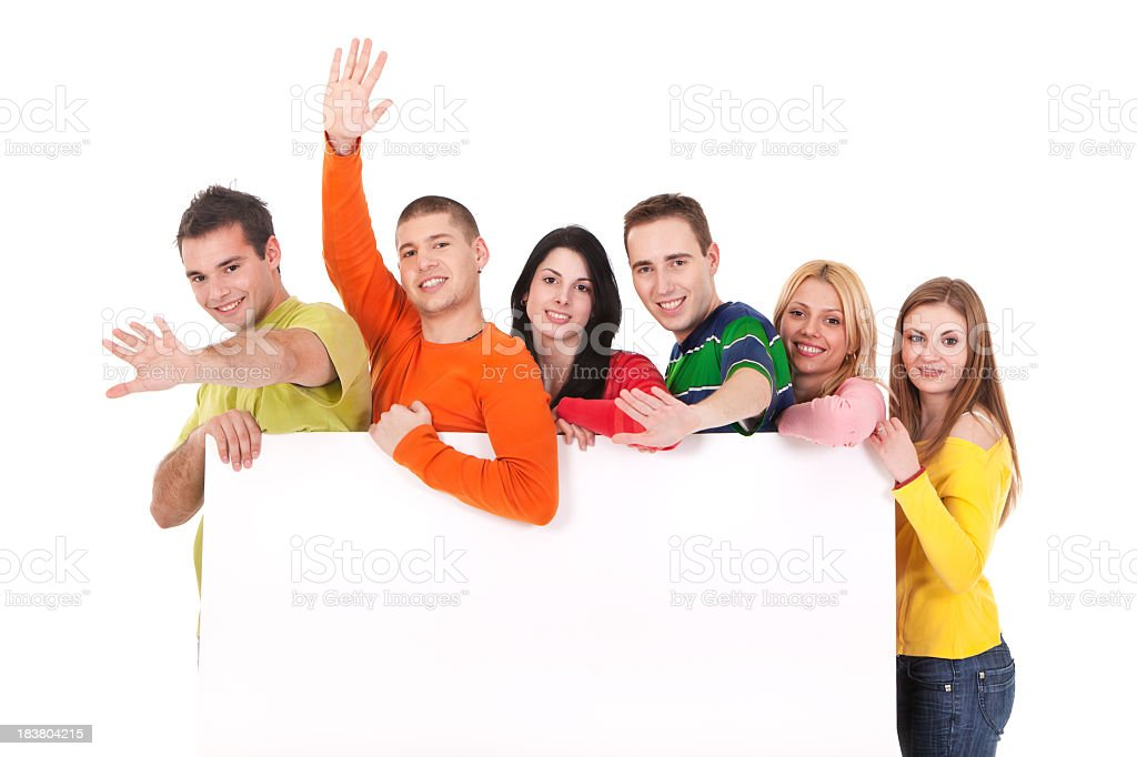 Group of young people holding blank banner royalty-free stock photo