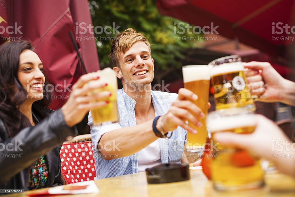 group of young people in a street cafe stock photo