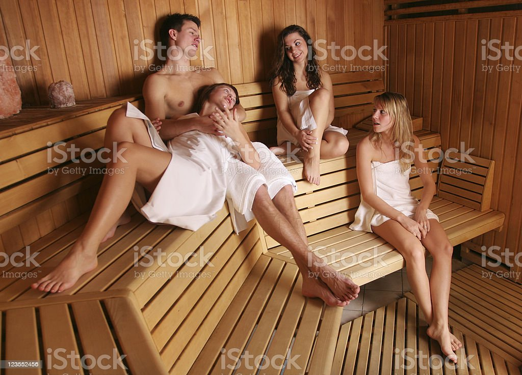 Group of young people in sauna royalty-free stock photo