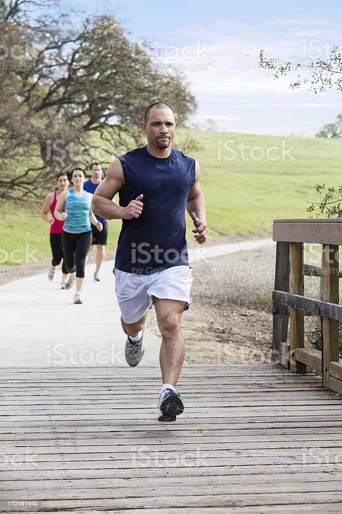 Group of young people jogging in the park royalty-free stock photo