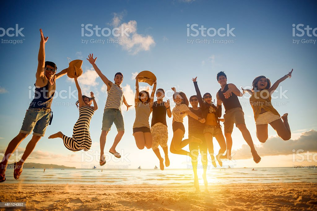 Group of young people jumping stock photo
