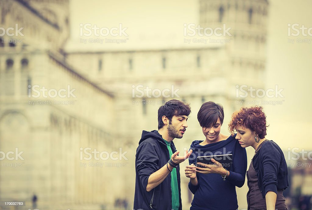 Group of young people looking at tablet PC royalty-free stock photo