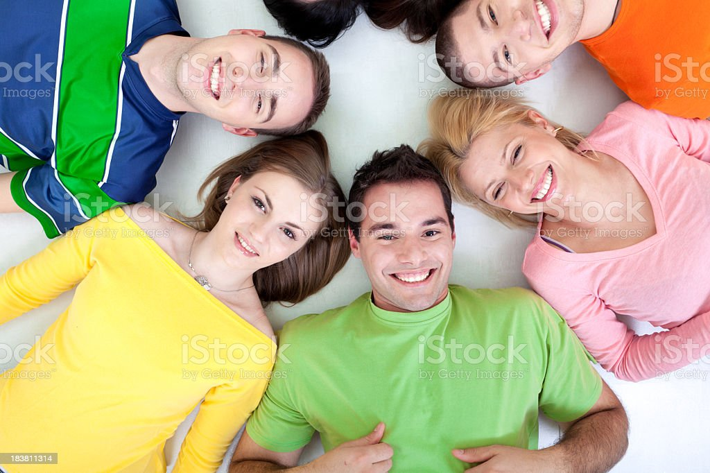 Group of young people lying in a circle royalty-free stock photo