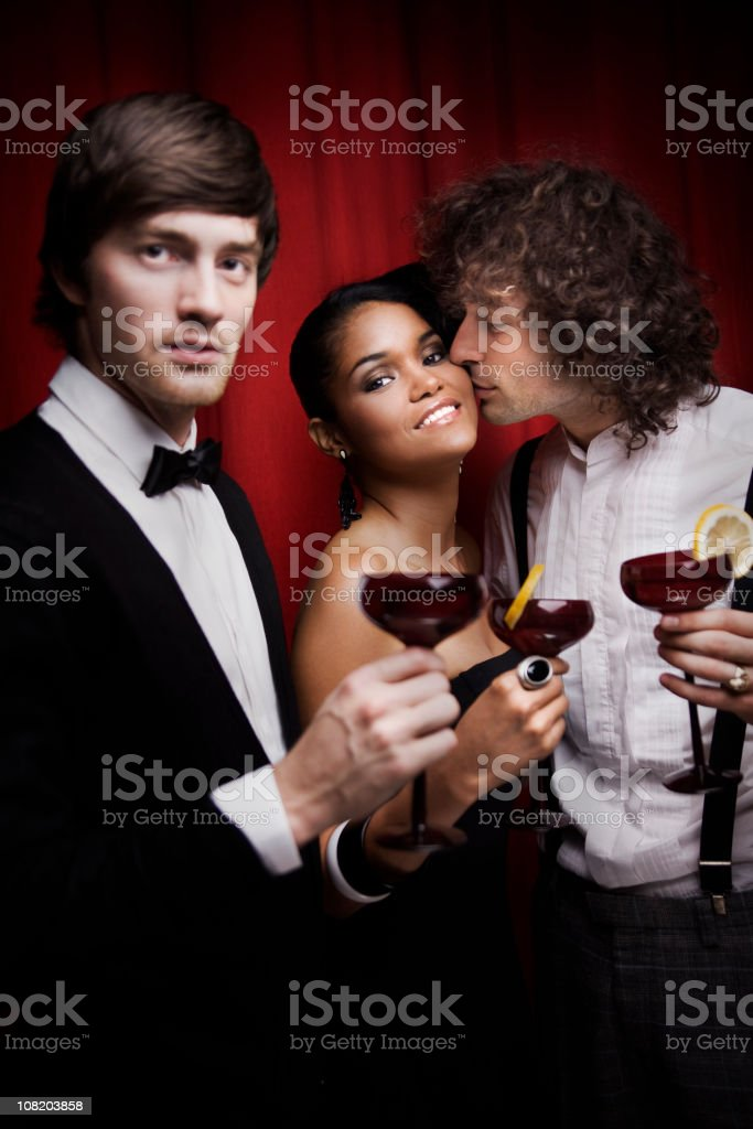 Group of Young People Making Toast with Drinks at Party royalty-free stock photo