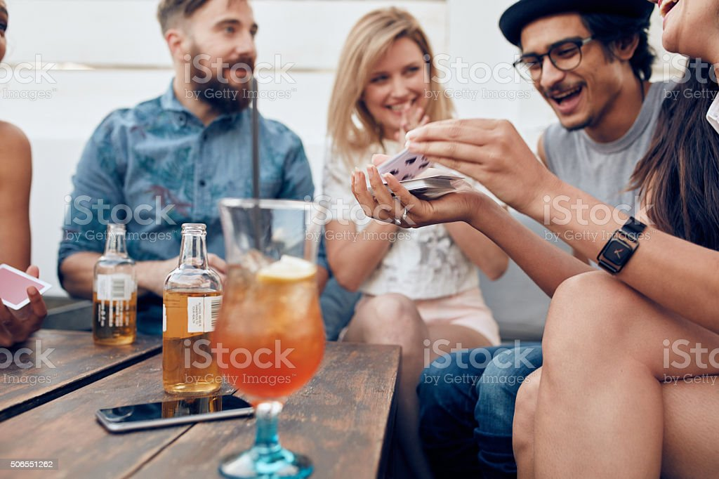 Group of young people playing cards stock photo