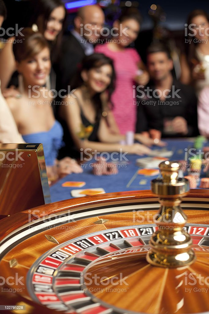 group of young people playing roulette stock photo