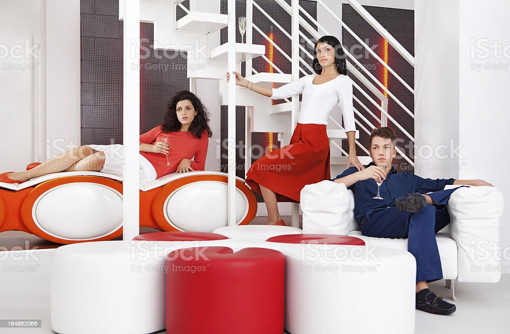 group of young people posing in modern interior royalty-free stock photo